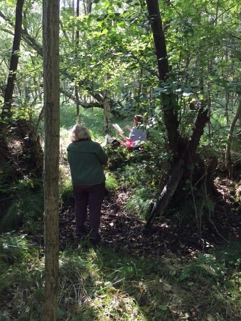 people sketching in the woods