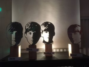 silhouettes of beatles heads