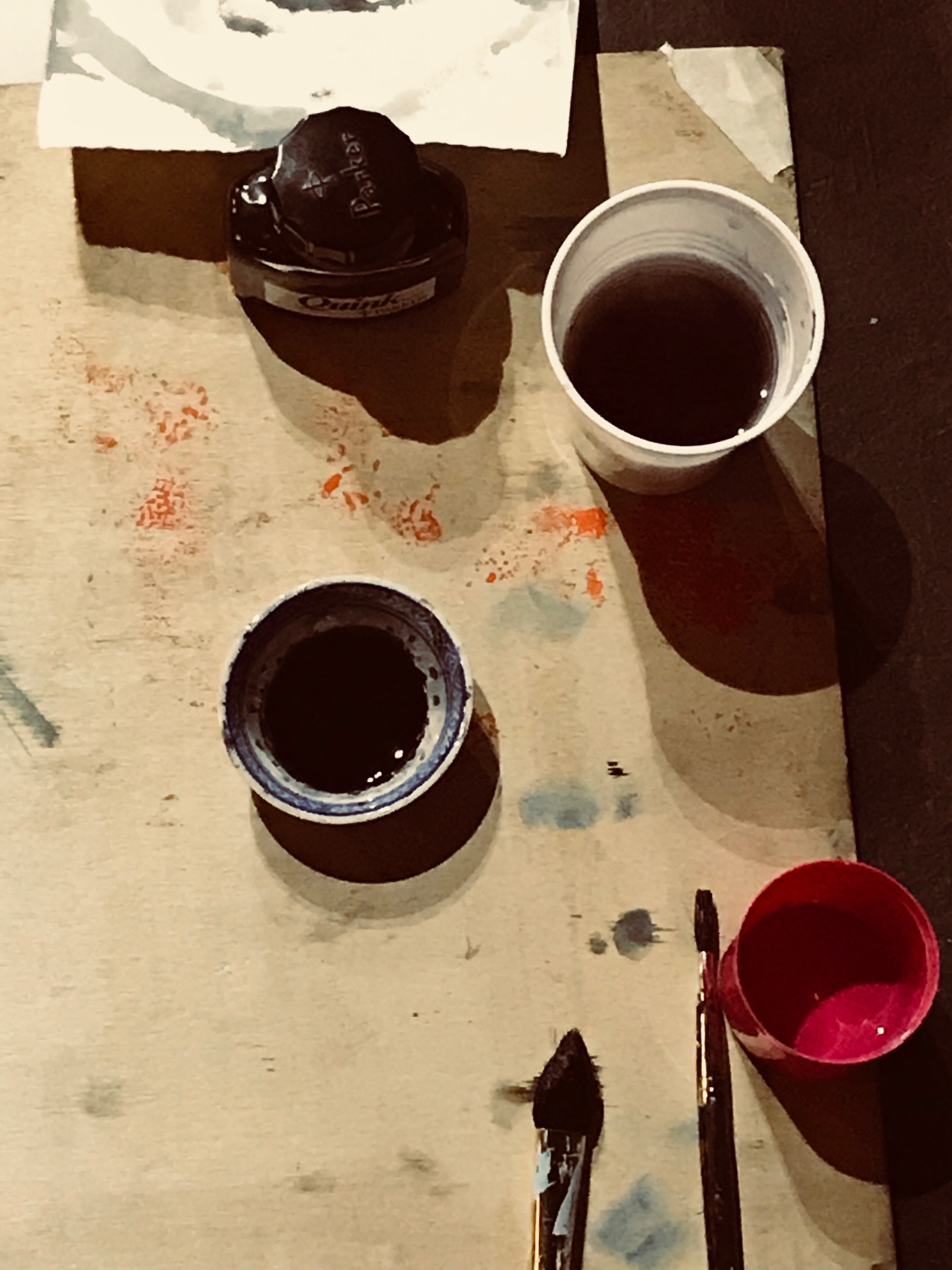 pots of ink and paintbrushes