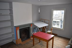 empty studio with fireplace and window
