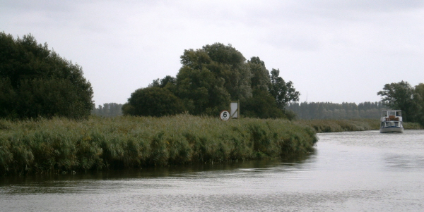 Looking across the grey blustery river as a boat approaches