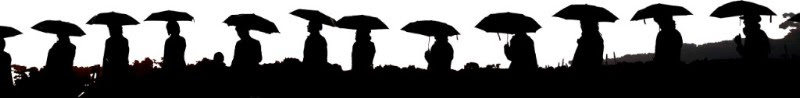 Open Voices B&W silhouette people with umbrellas