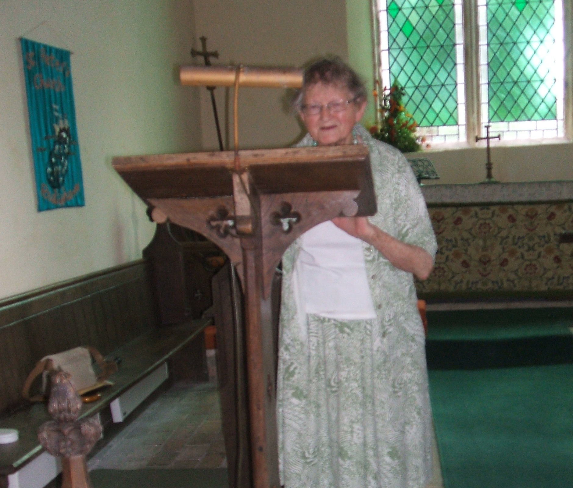 Angela Ottaway, Land Army girl now 92, reading a war poem at Redisham church.