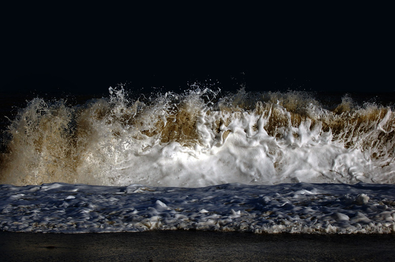 photograph of waves in night time